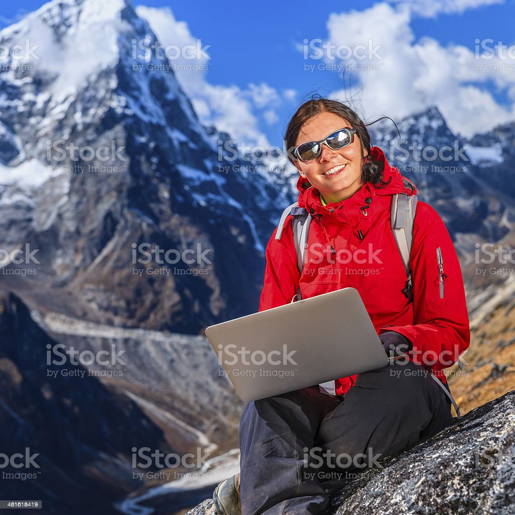 Woman is using laptop in Mount Everest National Park, Nepal royalty-free stock photo
