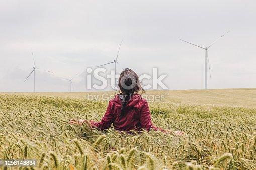 Woman is walking in wheat field