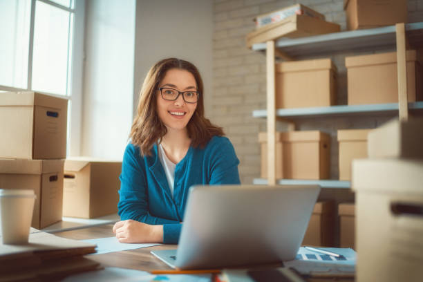 Woman is working at warehouse for online store. stock photo