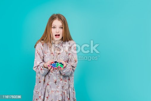 istock woman isolated over blue background 1161750236