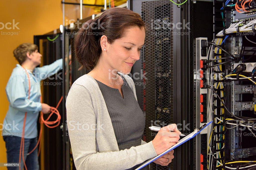 Woman IT engineer in server room stock photo