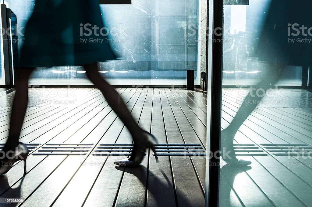 Woman it is glass door easy reflection stock photo