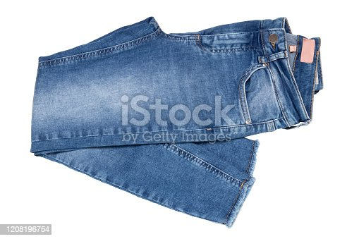 Woman jeans isolated. Folded trendy stylish female blue jeans trousers isolated on a white background. Fashionable denim pants for women.