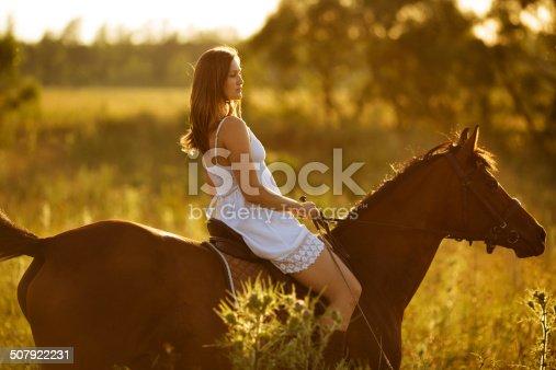 1128475475 istock photo Woman - jockey riding on a horse 507922231