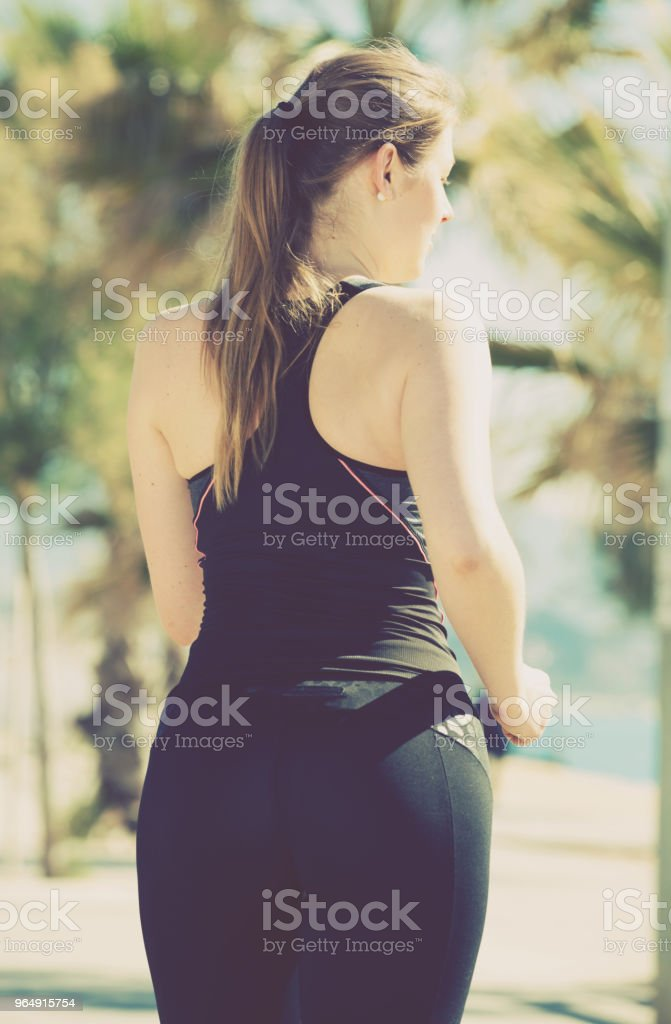 Woman jogging during outdoor workout royalty-free stock photo