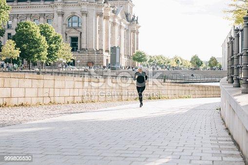 istock Woman jogging in Berlin. 999805530