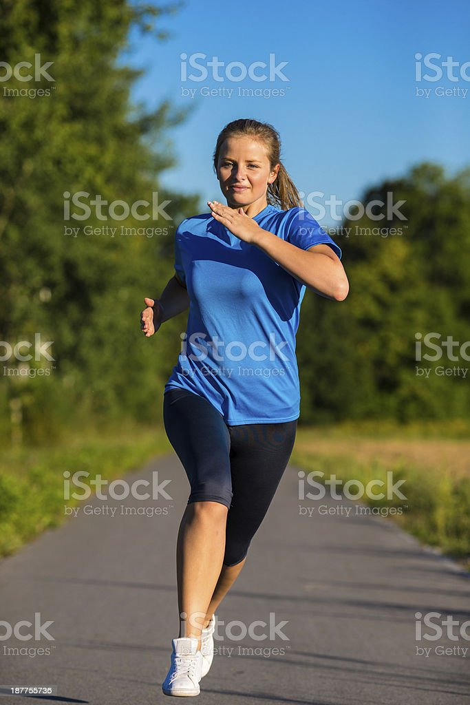 Woman jogging in park royalty-free stock photo