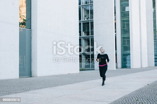 istock Woman jogging in the city. 999805618
