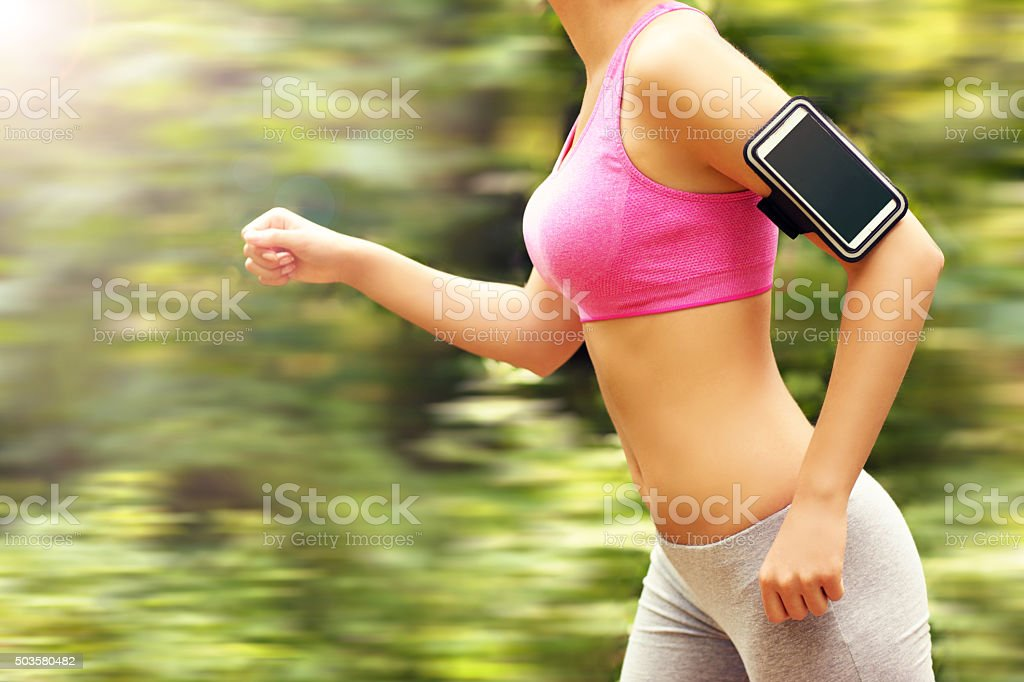 Woman jogging in the forest stock photo