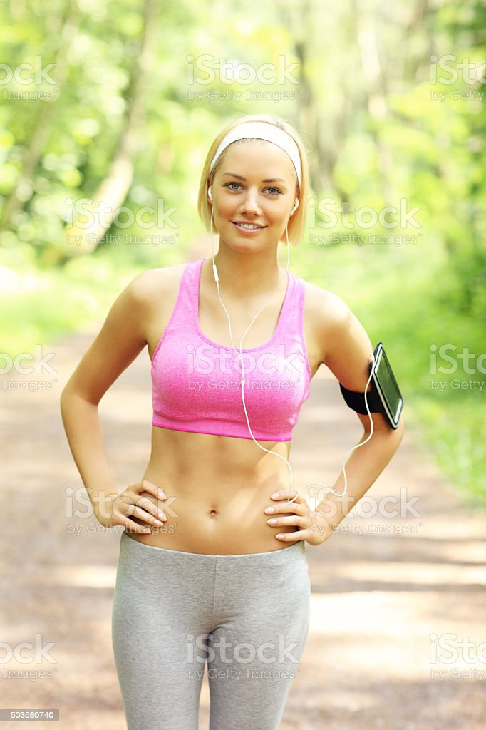 Woman jogging in the park stock photo