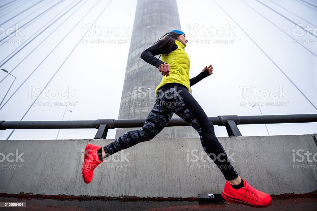 Woman jogging in the winter morning stock photo