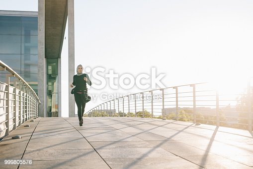 istock Woman jogging on a sunny evening. 999805576