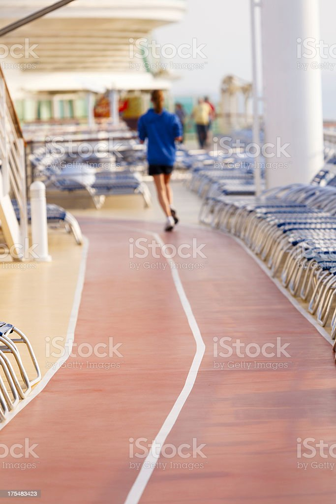 Woman jogging on cruise ship main deck stock photo
