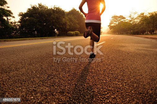 istock Woman jogging on road 489357673