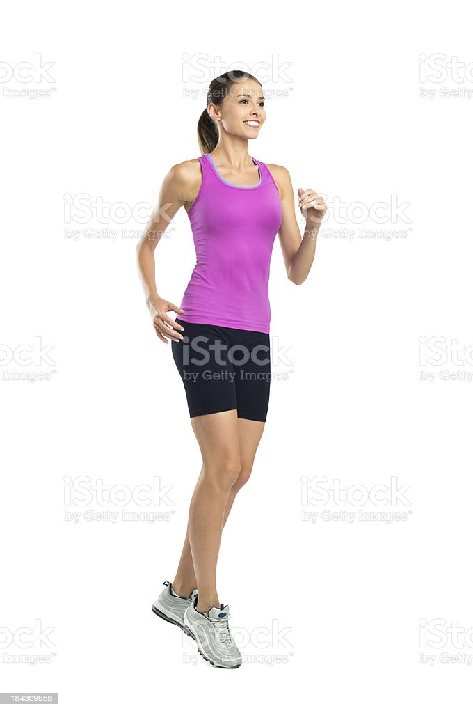 Woman jogging on white background stock photo