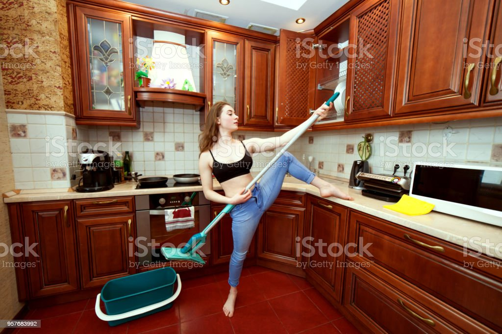 Woman jokes about the mop. stock photo