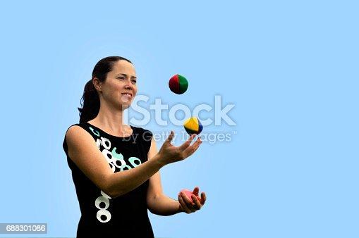 istock Woman Juggling Balls 688301086