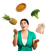 Subject: A young woman juggling a variety of food in the air. Isolated on white.