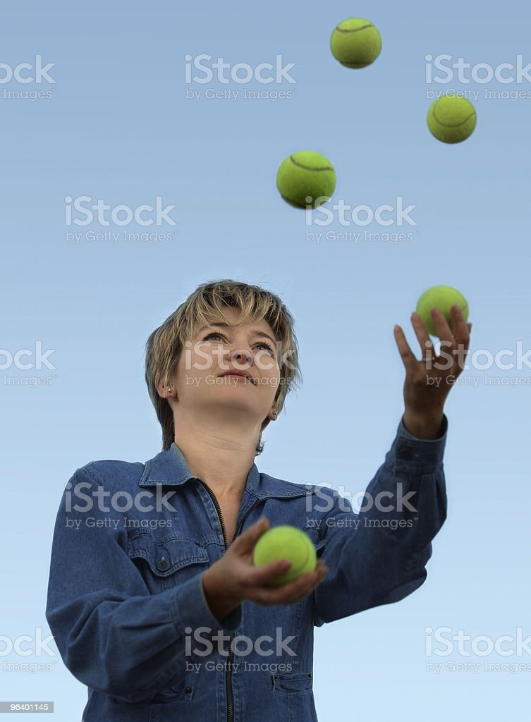 Woman juggling with tennis balls royalty-free stock photo