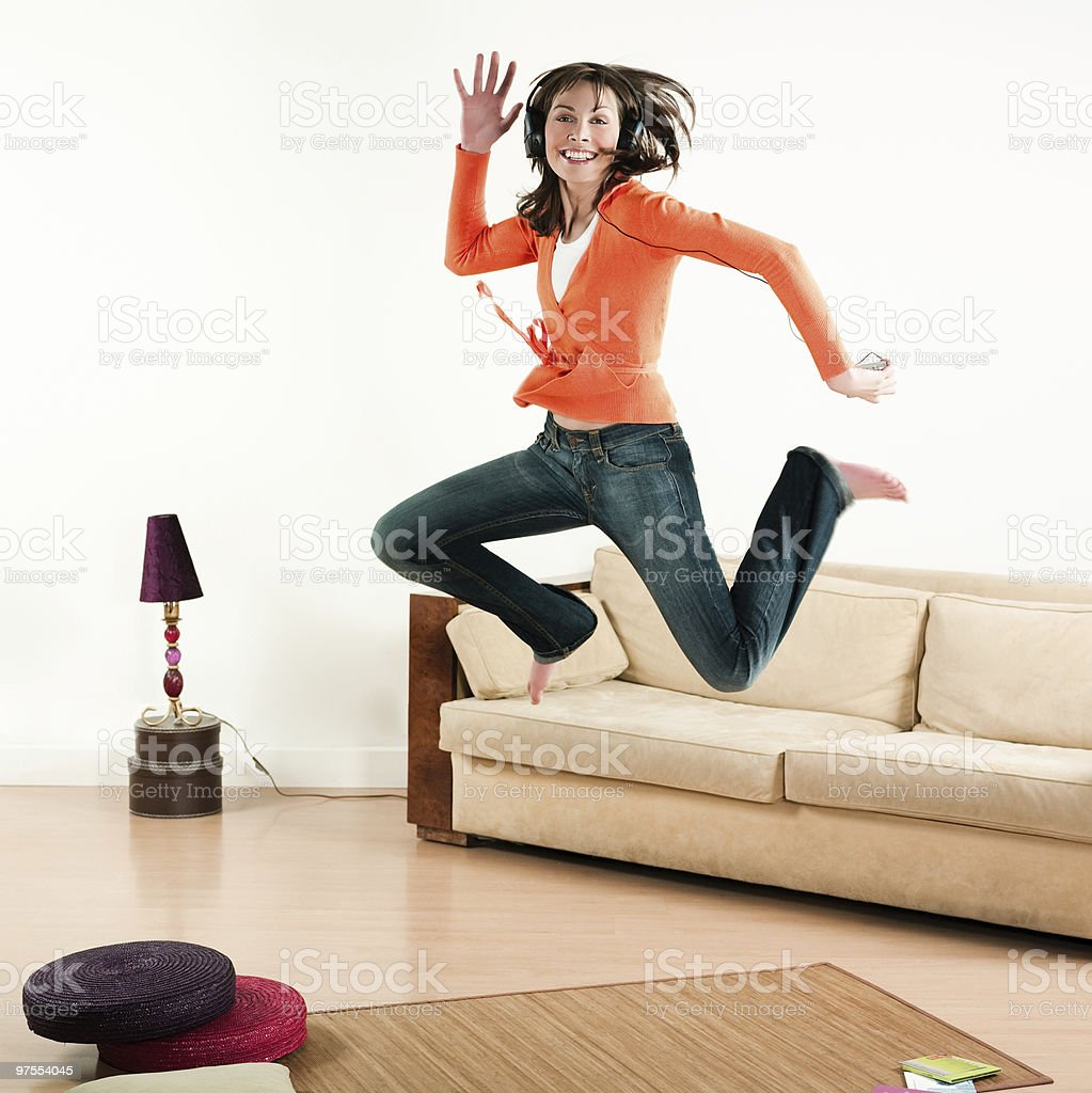 woman jumping and listening music royalty-free stock photo