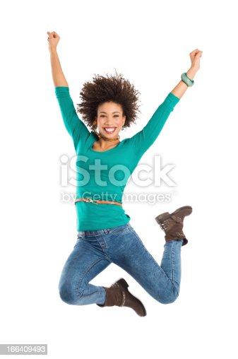 istock Woman Jumping In Joy 166409493