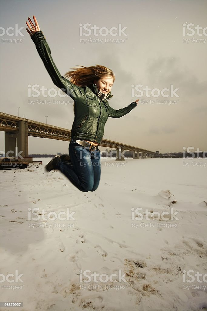 woman jumping in snow royalty-free stock photo