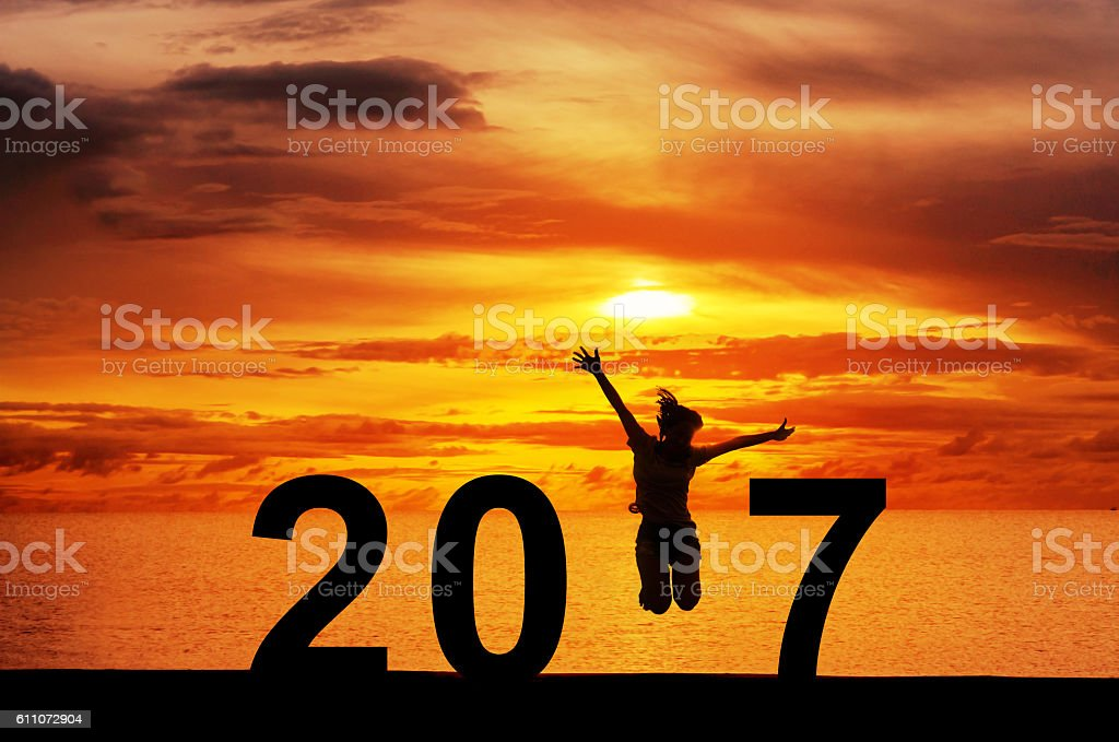 woman jumping New Year 2017 stock photo