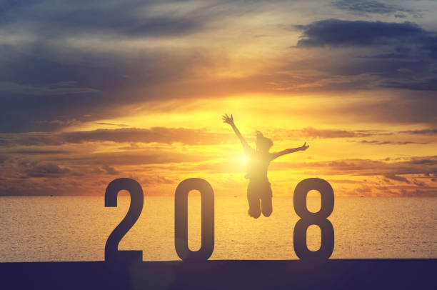 Woman jumping New Year 2018 stock photo