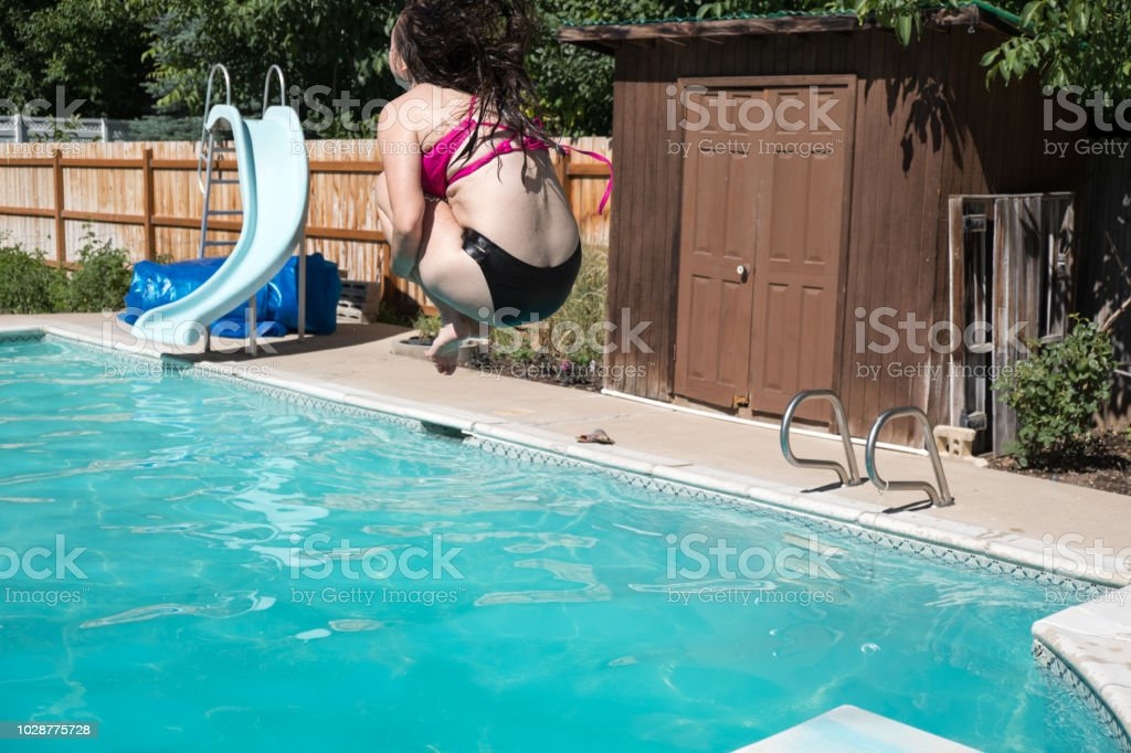 Woman Jumping Off Diving Board Doing A Cannon Ball Into A ...