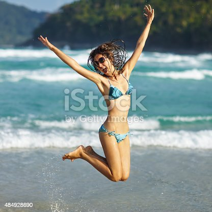 istock Woman jumping on the beach 484928690