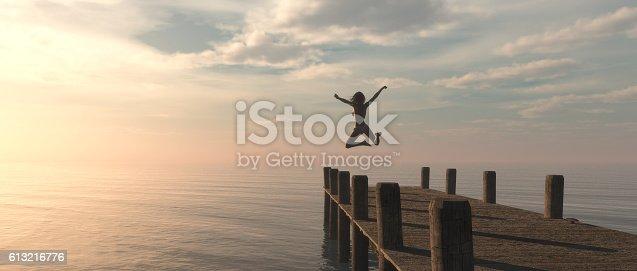 istock Woman jumping 613216776