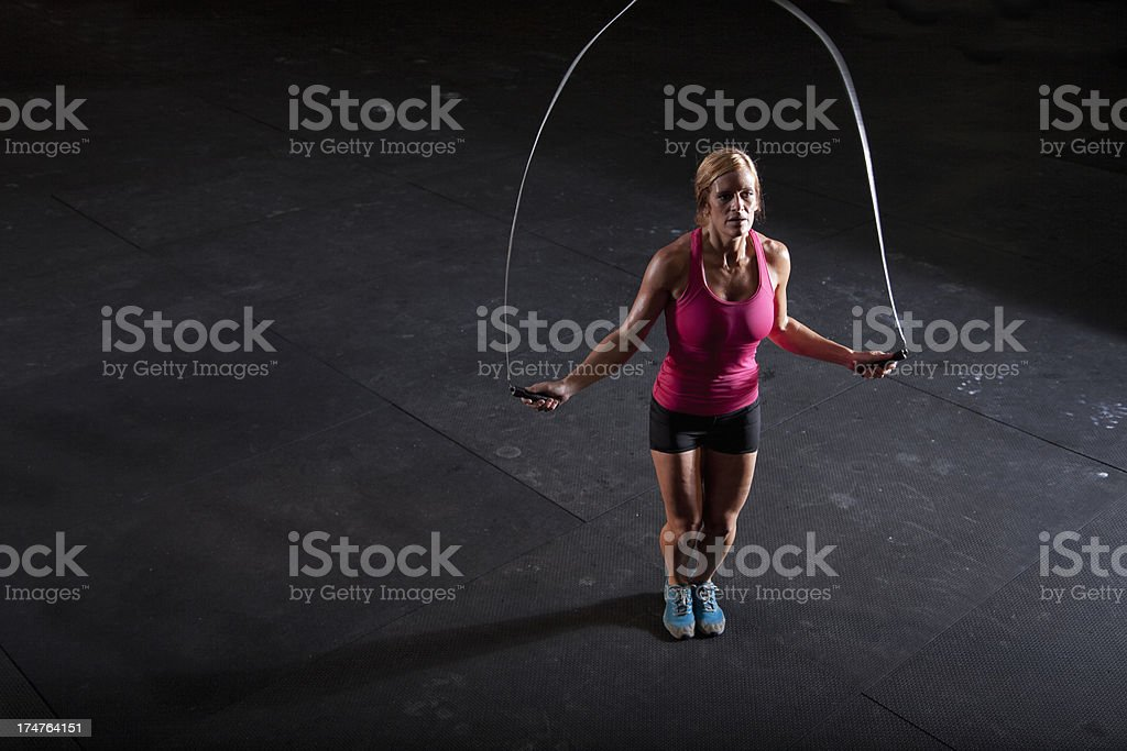 Woman jumping rope stock photo