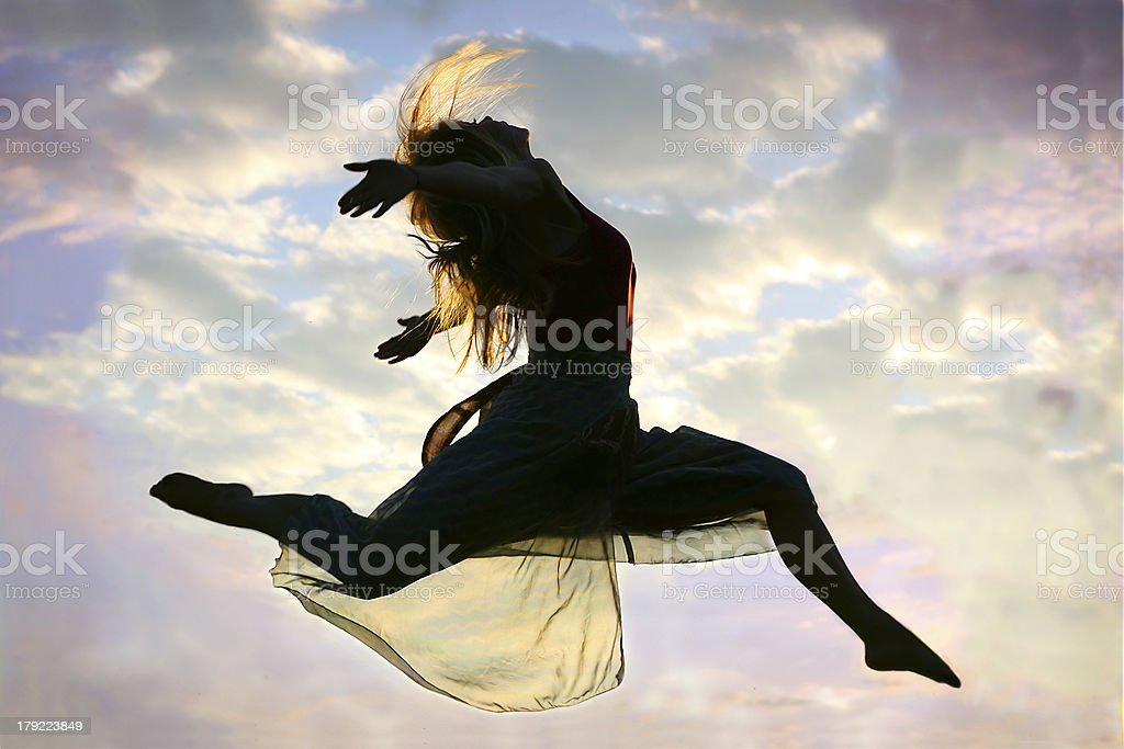 Woman Jumping through the Air royalty-free stock photo
