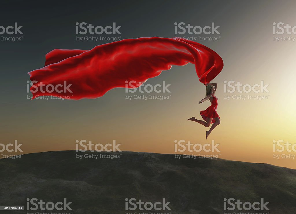 woman jumping with a red tissue stock photo