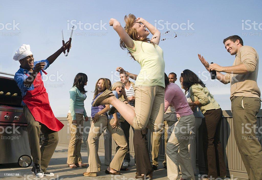 Woman Jumping with Joy at a Picnic stock photo