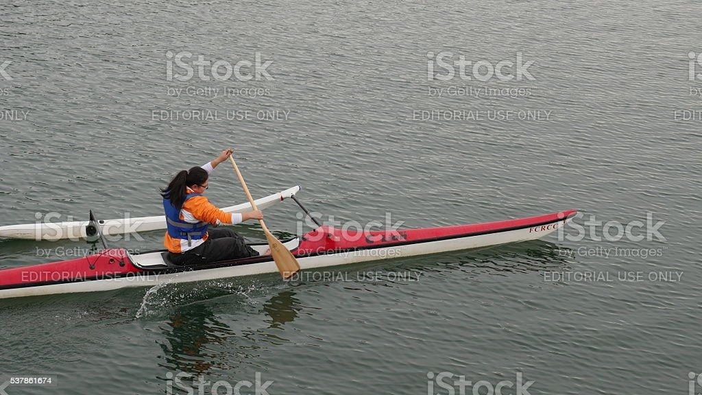 Woman Kayaking in False Creek stock photo