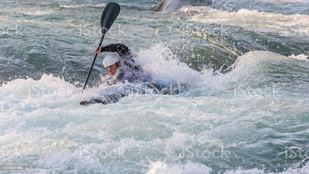 Woman kayaking stock photo