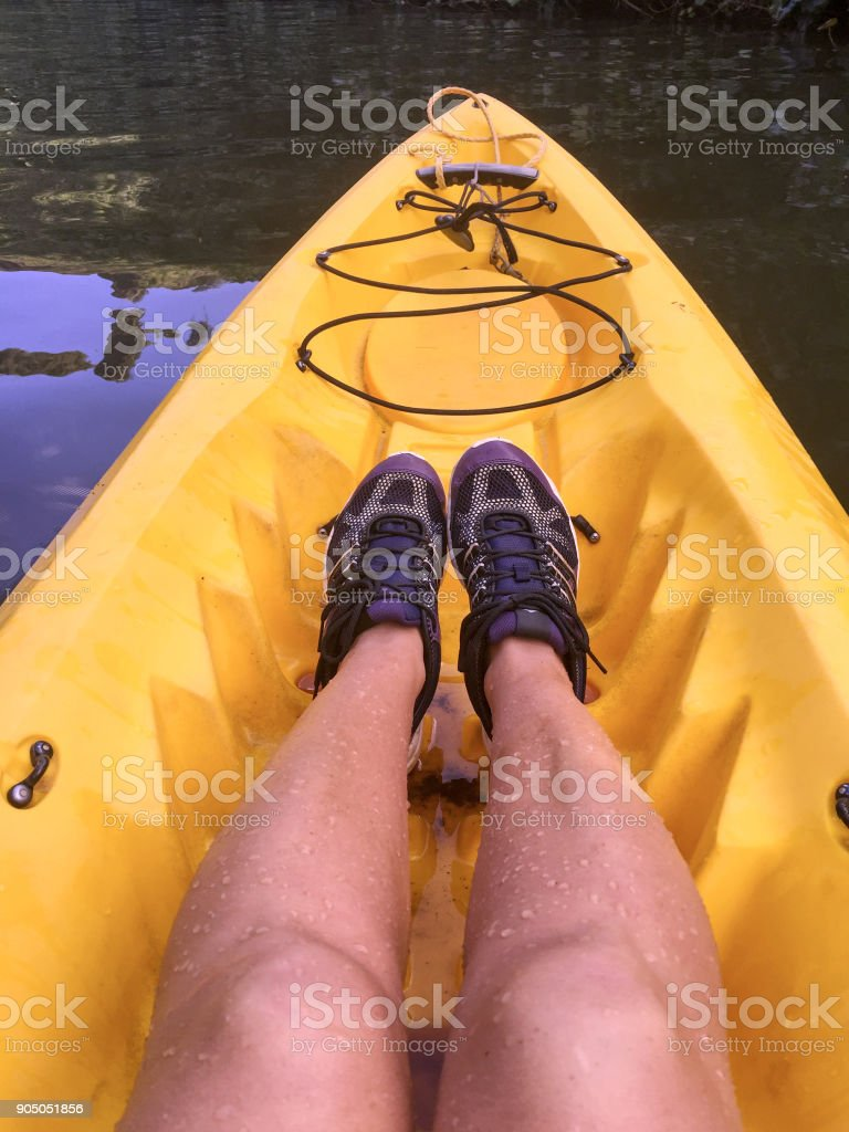 Woman kayaks on Wailua River, Kauai, Hawaii stock photo