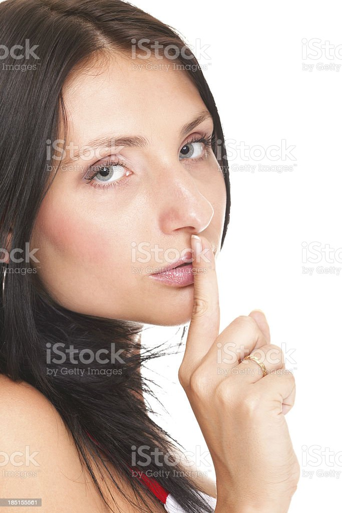 Woman keep quiet gesture finger on mouth isolated royalty-free stock photo
