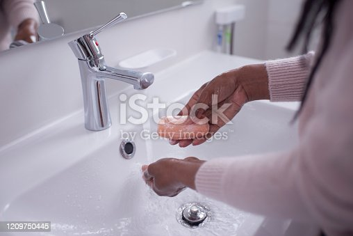 1182622704istockphoto A woman keeping hands clean. Hand washing. Hygiene. Healthy. 1209750445