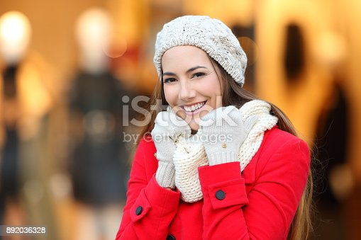 istock Woman keeping warm in winter in a mall 892036328