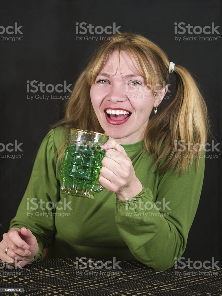 woman keeps glass of beer royalty-free stock photo