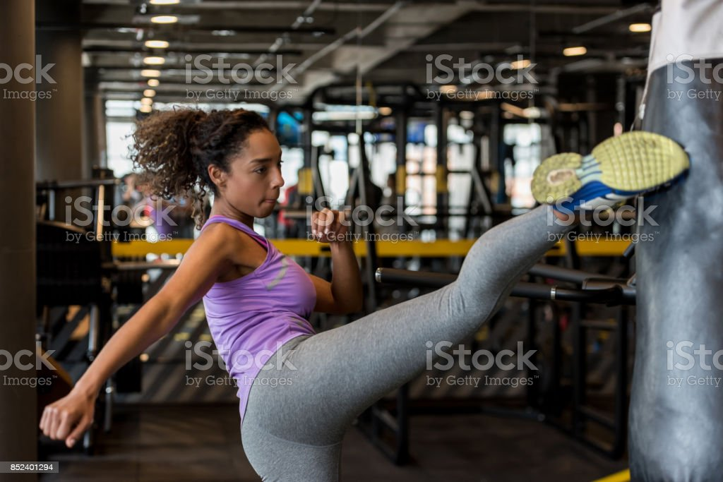 Woman kickboxing at the gym stock photo