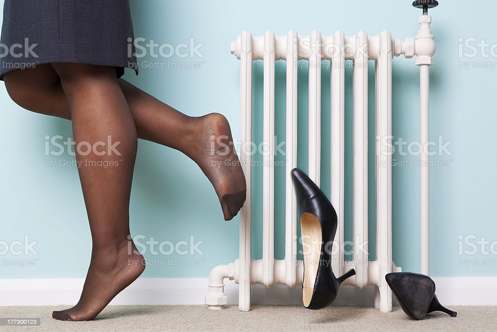 Woman kicking her heels off stock photo