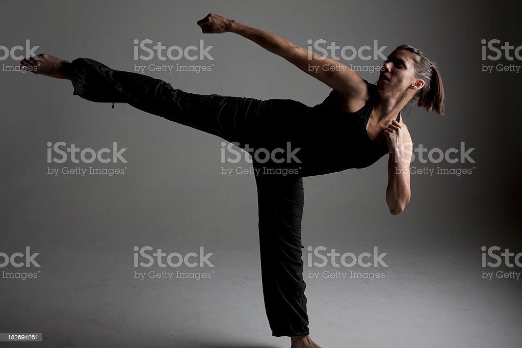 Woman kicking high stock photo