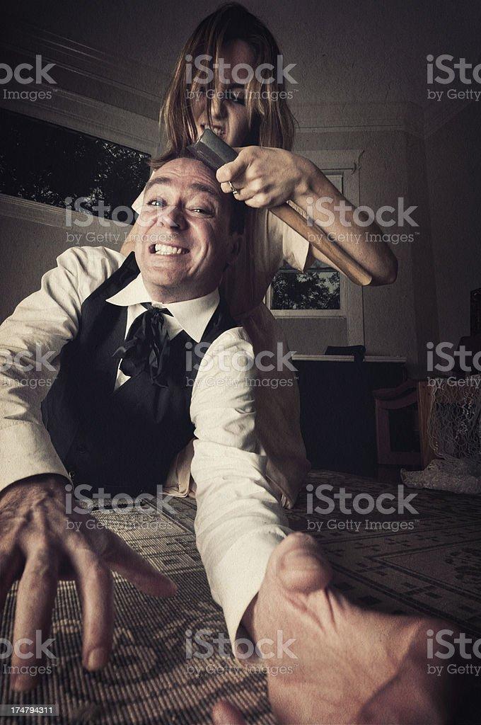Woman killing man with an axe - I royalty-free stock photo