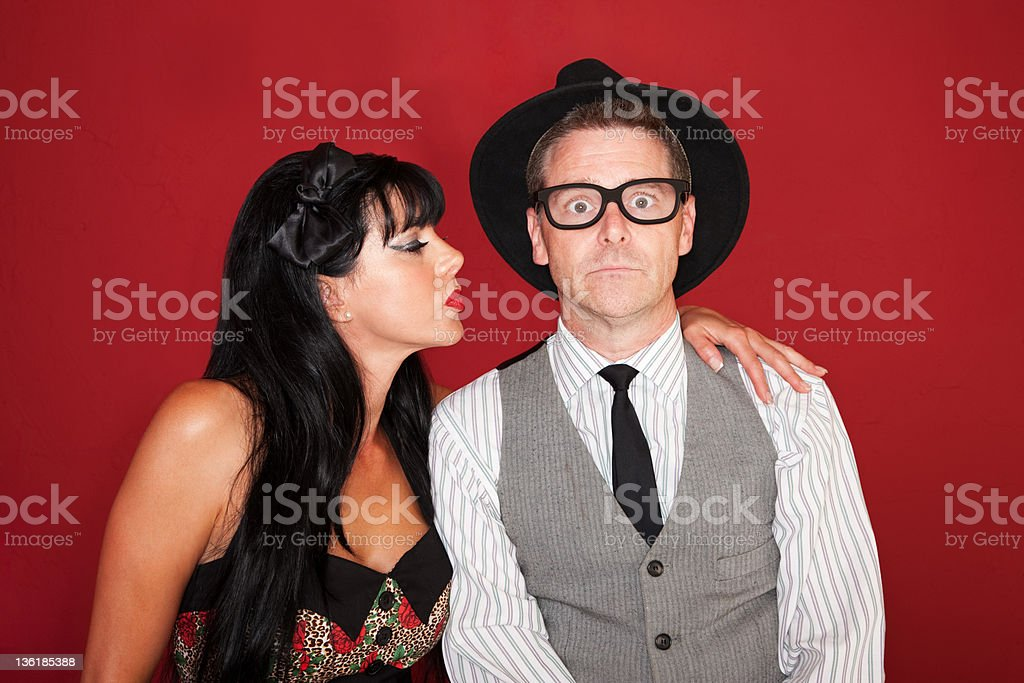 Woman Kisses Shy Man stock photo