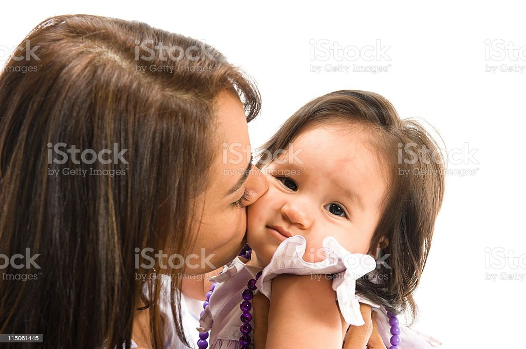 Woman Kissing Baby royalty-free stock photo