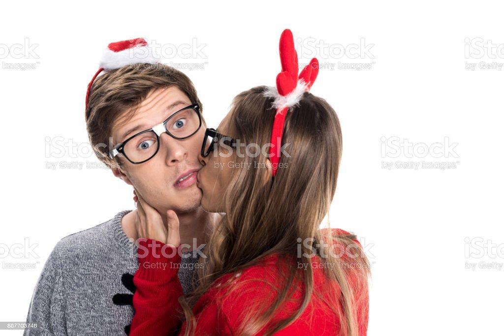 woman kissing boyfriend stock photo