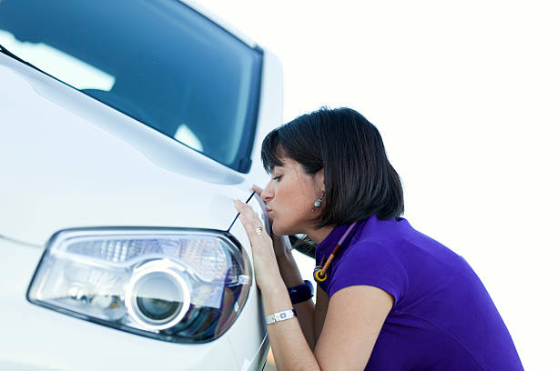 Woman kissing her new car stock photo
